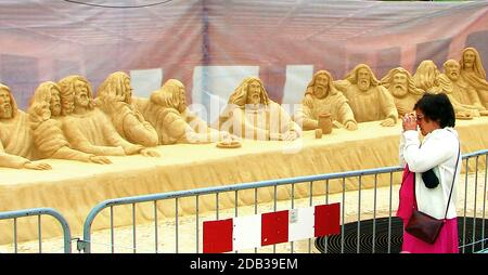 SAND ART - SEVILLE, SPAIN, in 2007. THE LAST SUPPER - The Last Supper sand sculpture group of disciples, seemingy pose for their photograph to be taken. In Christian belief the Last Supper was the final meal that, Jesus Christ shared with his apostles in Jerusalem before his crucifixion - Stock Photo