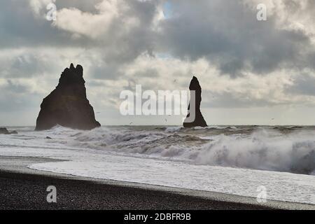 Waves at Rejnisfjara black sand beach, Reynisdrangar cliffs - Stock Photo