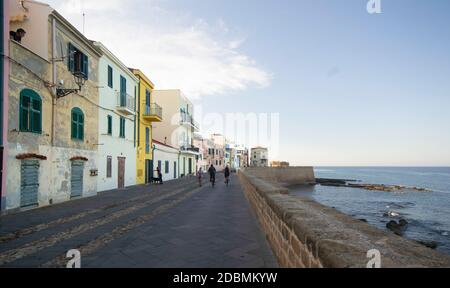 Waterfront in the coastal town of Alghero with incidental people walking, Sardinia, Italy