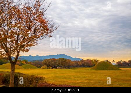 Sunset of Inwang-dong ancient tomb complex at autumn in Gyeongju, Korea - Stock Photo