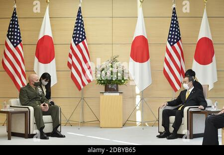Japanese Prime Minister Yoshihide Suga (R) and U.S. Marine Corps Commandant Gen. David Berger hold talks in Tokyo on Nov. 18, 2020, wearing face masks amid the coronavirus pandemic. (Kyodo)==Kyodo Photo via Credit: Newscom/Alamy Live News Stock Photo
