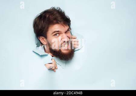 emotional men breaks through the wall career work lifestyle - Stock Photo