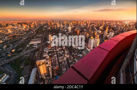 Wide Angle Skyscraper View of Bangkok, Thailand. Cityscape in Evening Golden Light at Sunset.