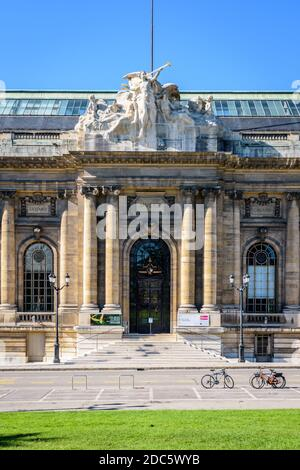 Front view of the entrance of the Museum of Art and History in Geneva on a sunny summer morning.