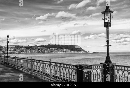 The terrace of Scarborough Spa entertainment centre overlooking the bay.  Scarborough town and castle are in the distance.
