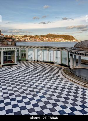 Scarborough Spa entertainment centre.  The foreground consists of a chequered floor and dome with Scarborough town and castle in the distance.
