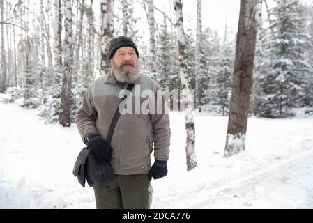 Tomsk, Russia. 18th Nov, 2020. Andrei Sharashkin, who travels around Russia on foot, walks along a street in the city of Tomsk. Military veteran and history teacher from Tyumen, Sharashkin set off in Moscow in 2018, covered Russia's southern regions, and reached the Far East. Currently, he is on his way home. At the end of the trip, Sharashkin is going to write several books. Credit: Taisiya Vorontsova/TASS/Alamy Live News - Stock Photo