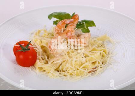 Italian pasta Linguini with prawns served basil