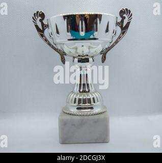 silver trophy Cup isolated on white background, close-up Stock Photo