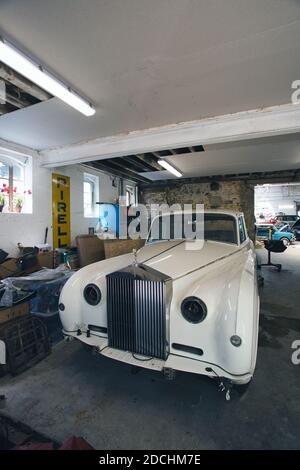 rolls royce car partly taken apart/stripped down for restoration in a domestic garage/workshop. - Stock Photo