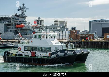 Portsmouth, UK - September 8, 2020: The passenger tender SD Netlet heading away from the quayside to pick up passengers from one of the Royal Navy shi - Stock Photo
