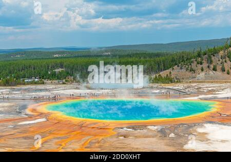 Aerial landscape of the Grand Prismatic Spring with elevated walkway and people walking, Yellowstone national park, Wyoming, USA.