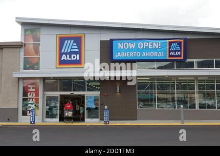 """Burbank, CA / USA - Oct. 25, 2020: A new and modern ALDI discount grocery store location, with a """"NOW OPEN!"""" sign is shown in an exterior view."""