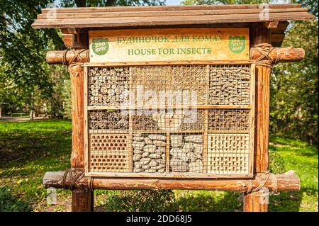 insect house for bugs and bees made of wood, bricks, cones and straw in Kyiv Zoo - Stock Photo
