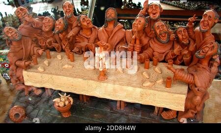 Madeira 2007 - Irreverent religious miniature hand made sculpture depiction of The Last Supper.In Christian belief the Last Supper was the final meal that, Jesus Christ shared with his apostles in Jerusalem before his crucifixion - Stock Photo