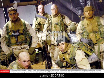 NO FILM, NO VIDEO, NO TV, NO DOCUMENTARY - © Andrew Cutraro/KRT/ABACA. 42604-1. Kuwait, 02/02/2003. Marines from Lima Company, 3rd Battalion, 7th Marines are debriefed following a night security mission in the Kuwait desert, recently, outside their base at Living Support Area 7. Battle training ha - Stock Photo