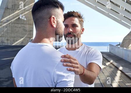 Gay man with boyfriend at Parc del Forum, Barcelona, Spain