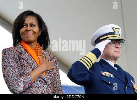 NO FILM, NO VIDEO, NO TV, NO DOCUMENTARY - First lady Michelle Obama, left, and Coast Guard Admiral Robert Papp stand for the playing of the National Anthem during a ceremony for the Coast Guard Cutter Stratton on Coast Guard Island in Alameda, CA, USA ON March 31, 2012. The first lady made the trip to California to join in the commissioning ceremony placing the ship into active service. Photo by Anda Chu/Oakland Tribune/MCT/ABACAPRESS.COM - Stock Photo