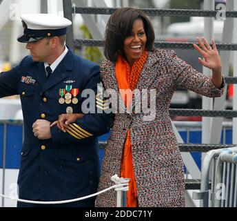 NO FILM, NO VIDEO, NO TV, NO DOCUMENTARY - First lady Michelle Obama, right, escorted by Coast Guard Senior Chief David Stephens, waves to members of the audience during her entrance from the Coast Guard Cutter Stratton for a ceremony on Coast Guard Island in Alameda, CA, USA ON March 31, 2012. The first lady made the trip to California to join in the commissioning ceremony placing the ship into active service. Photo by Anda Chu/Oakland Tribune/MCT/ABACAPRESS.COM - Stock Photo