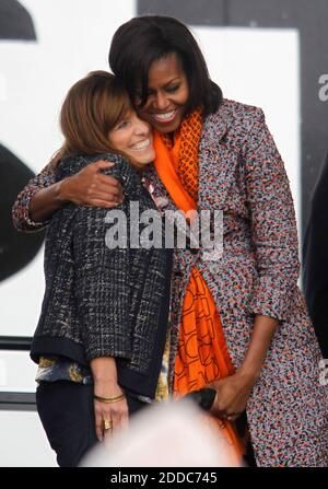 NO FILM, NO VIDEO, NO TV, NO DOCUMENTARY - First lady Michelle Obama gives Melinda Cook, a descendant of Dorothy Stratton, a hug during a ceremony for the Coast Guard Cutter Stratton on Coast Guard Island in Alameda, CA, USA ON March 31, 2012. The first lady made the trip to California to join in the commissioning ceremony placing the ship into active service. Mrs. Obama, a sponsor of the Cutter Stratton, helped christen the ship in Pascagoula, Mississippi, in 2010 by breaking a champagne bottle over the bow. Photo by Anda Chu/Oakland Tribune/MCT/ABACAPRESS.COM - Stock Photo