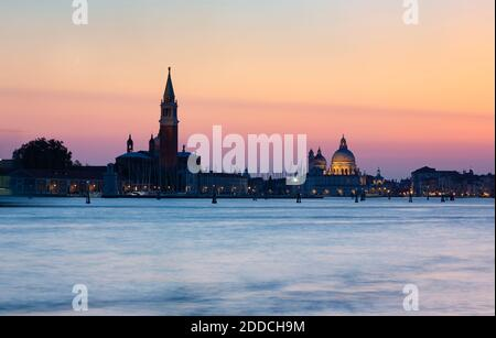 Italy, Veneto, Venice, Venetian waterfront at dusk with Santa Maria della Salute and San Giorgio Maggiore churches in background Stock Photo