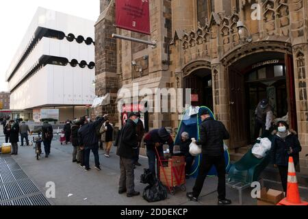New York, New York, USA. 24th Nov, 2020. The Church of the Village hands out food during a weekly food distribution in New York, New York. Nearly 300 people received groceries and other food officials said Credit: Brian Branch Price/ZUMA Wire/Alamy Live News Stock Photo