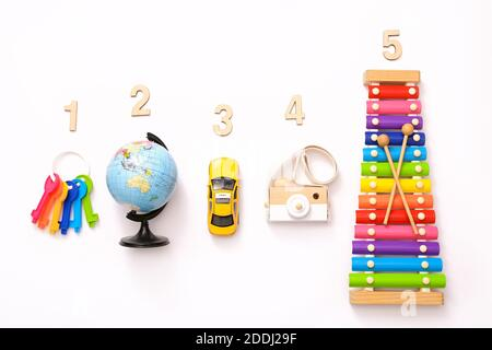Colorful kids toys on white background. Top view