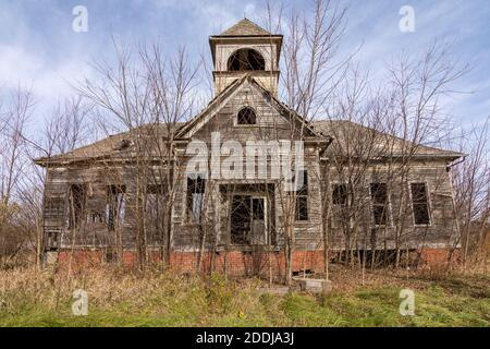 Dilapidated  old schoolhouse in the afternoon light.  Elmira, Illinois.