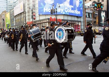 New York, New York, USA. 25th Nov, 2020. Members of the NYPD Marching Band during the recording of Macy's Thanksgiving Parade during COVID-19. This year, the Parade will be produced in a closed tv-set format over the course of several days leading up to and including Thanksgiving to ensure the safety of participants and staff. Credit: Syed Yaqeen/ZUMA Wire/Alamy Live News - Stock Photo