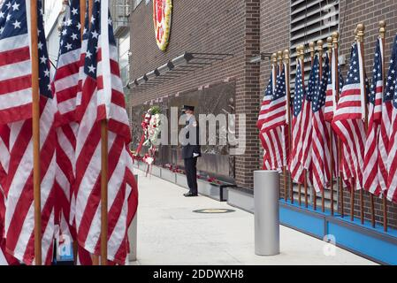 Manhattan, New York. September 11, 2020. FDNY firefighter wearing a mask stands guard at the FDNY Memorial Wall near the World Trade Center. Stock Photo