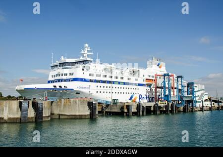 Portsmouth, UK - September 8, 2020: Side view of the large passenger ferry Normandie run by Brittany Ferries moored in Portsmouth Harbour on a sunny s - Stock Photo