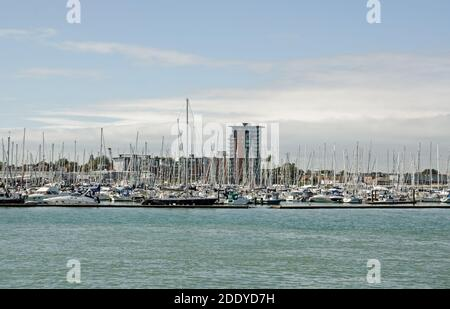 Gosport, UK - September 8, 2020: View across Portsmouth Harbour towards Weevil Lake, Gosport Marina and the new Rope Quays housing development on a su - Stock Photo