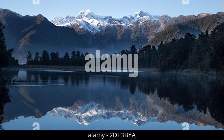 Lake Matheson providing stunning reflections of New Zealand's highest peaks - Aoraki (Mount Cook) and Mount Tasman.
