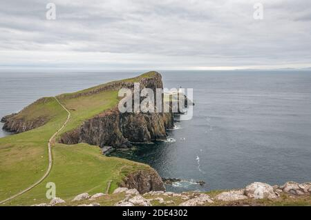 Neist Point lighthouse from Neist Cliff viewpoint, isle of Skye, Scotland. Concept: famous natural landscape, Scottish landscape, tranquility and sere - Stock Photo