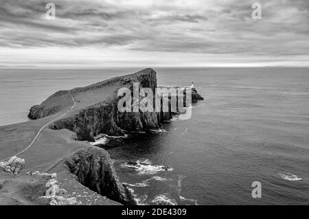 Neist Point lighthouse from Neist Cliff viewpoint black and white effect, isle of Skye, Scotland. Concept: famous natural landscape, Scottish landscap - Stock Photo