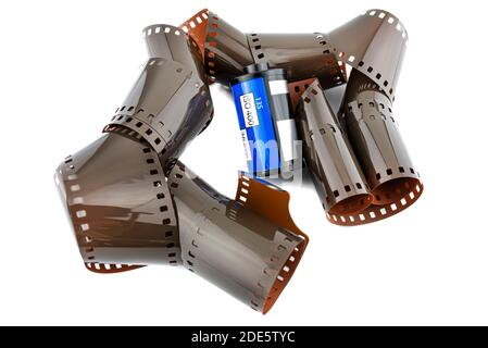 Unfolded new ISO 400 film coming from a blue roll, isolated on a white background. - Stock Photo