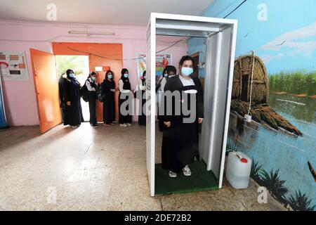 Baghdad. 29th Nov, 2020. Students go through disinfection procedures before entering classrooms at a school in Baghdad, Iraq, on Nov. 29, 2020. The Iraqi Health Ministry reported on Sunday 1,614 new COVID-19 cases, bringing the nationwide infections to 550,435. New school year has started across Iraq on Nov. 29. Credit: Xinhua/Alamy Live News