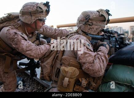 Baghdad, Iraq. 29th Nov, 2020. U.S. Marines with 2nd Battalion, 7th Marines, assigned to the Special Purpose Marine Air-Ground Task Force-Crisis Response-Central Command (SPMAGTF-CR-CC) 19.2, reinforce the Baghdad Embassy Compound in Iraq, on January 1, 2020. Dozens of angry Iraqi Shiite militia supporters broke into the U.S. Embassy compound in Baghdad on Tuesday, December 31, 2019, after smashing a main door and setting fire to a reception area. Photo by Sgt. Kyle C. Talbot/U.S. Marine Corps/UPI Credit: UPI/Alamy Live News