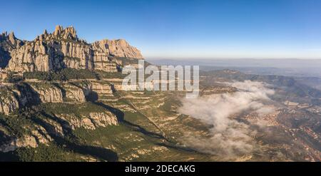 Panoramic aerial drone view of Montserrat mountain range and its valley near Barcelona