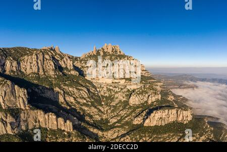 Aerial drone view of Abbey of Montserrat mountain near Barcelona in morning sunrise