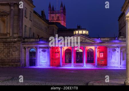 The Romans Baths lit with colourful festive projected illuminations part of the 2020 Christmas Lights display. Bath City Centre, Somerset, England UK - Stock Photo