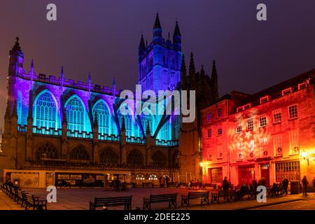 Bath Abbey lit with colourful illuminations and is part of the 2020 Christmas Light Trail in Bath City Centre, Somerset, England, UK - Stock Photo