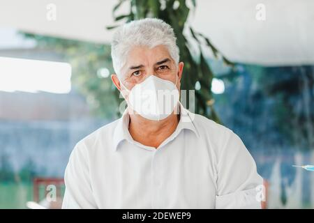latin elderly man with facemask ready for vaccine for coronavirus pandemic covid in Mexico city