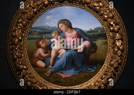 Alba Madonna, Mary, Jesus, and John the Baptist by Italian Renaissance master Raphael displayed at the exhibition 'Raffaello' at the Scuderie del Quirinale in Rome, Italy on March 4, 2020. Rome hosts the biggest ever exhibition entirely devoted to Raffaello Sanzio da Urbino, better known as Raphael, on the 500th anniversary of the death of the High Renaissance artist and architect. The exhibition, titled simply 'Raphael' is scheduled from 5 March until 2 June. Photo: Eric Vandeville/ABACAPRESS.COM - Stock Photo