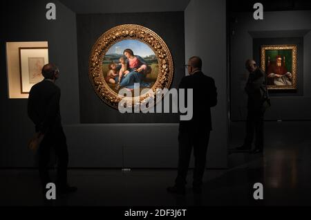 People look at the painting ' Alba Madonna ' and 'Portrait of pope Julius II' by Italian Renaissance master Raphael displayed at the exhibition 'Raffaello' at the Scuderie del Quirinale in Rome, Italy on March 4, 2020. Rome hosts the biggest ever exhibition entirely devoted to Raffaello Sanzio da Urbino, better known as Raphael, on the 500th anniversary of the death of the High Renaissance artist and architect. The exhibition, titled simply 'Raphael' is scheduled from 5 March until 2 June. Photo: Eric Vandeville/ABACAPRESS.COM - Stock Photo