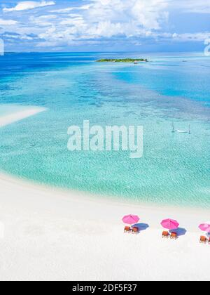 Amazing aerial landscape in Maldives islands. Perfect blue sea and coral reef view from drone or plane. Exotic summer travel and vacation landscape