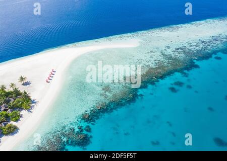 Amazing aerial landscape in Maldives islands. Perfect blue sea and coral reef view from drone or plane. Exotic summer travel and vacation landscape - Stock Photo