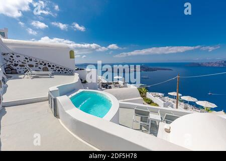 White architecture on Santorini island, Greece. Swimming pool in luxury hotel. Beautiful view on the sea, summer vacation, travel destination stunning - Stock Photo