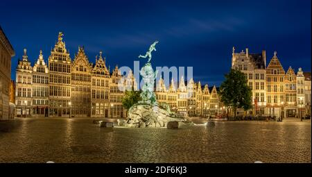 Brabo fountain at the Grote Markt square in Antwerp after sunset - Stock Photo