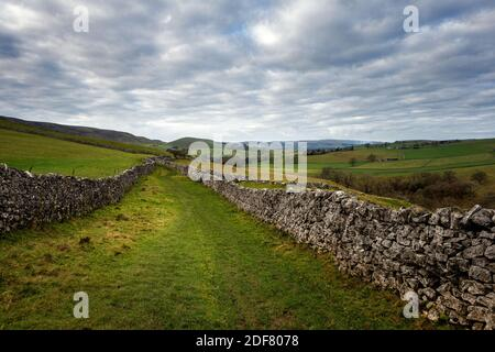 UK landscape: Stunning double walled path near Burnsall in the Yorkshire Dales National Park, North Yorkshire, England